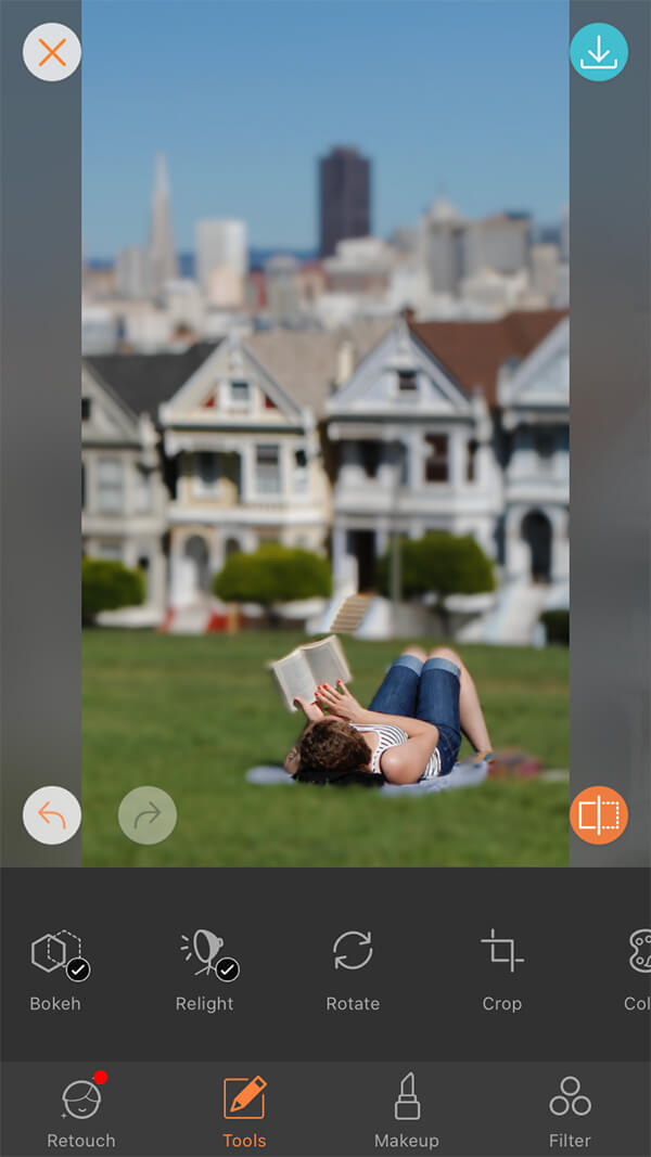 woman reads book on green lawn in San Francisco park