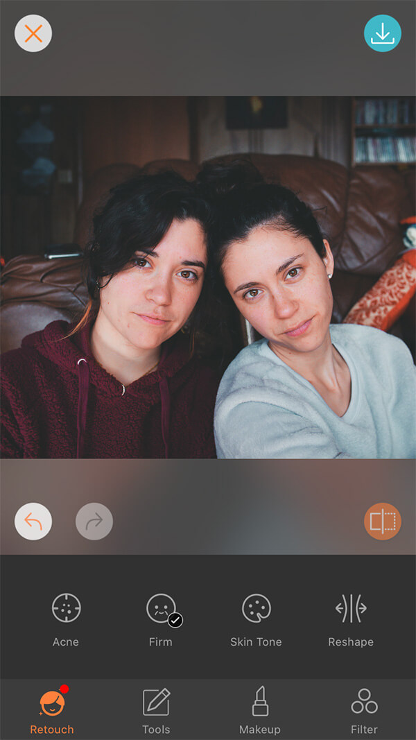 photo of female twins one wearing a red hoodie and the other in grey sweater