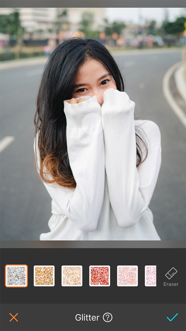 girl with black hair in white sweater standing in the road