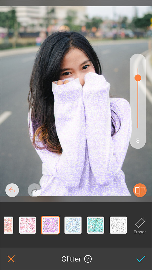 girl with black hair in purple sweater standing in the road