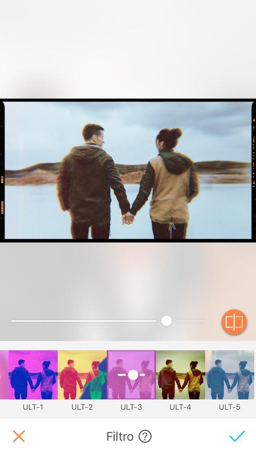 edición de foto de pareja agarrándose de las manos y viendo al agua congelada con filtro de colores