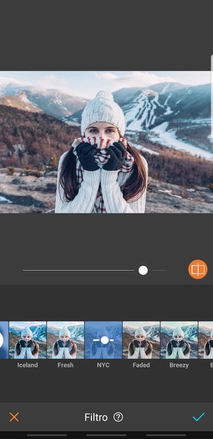 mujer en la montaña con ropa de invierno
