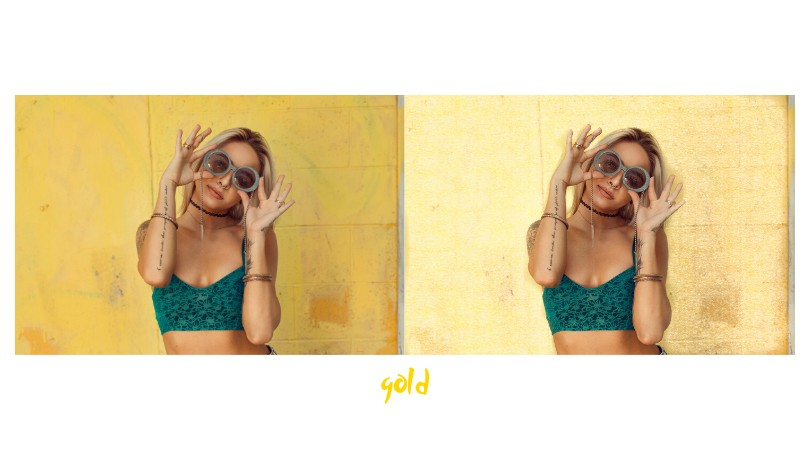 woman wearing a green crop top and sunglasses standing in front of a yellow wall
