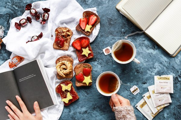 breakfast flat lay with french toast, fruits and tea