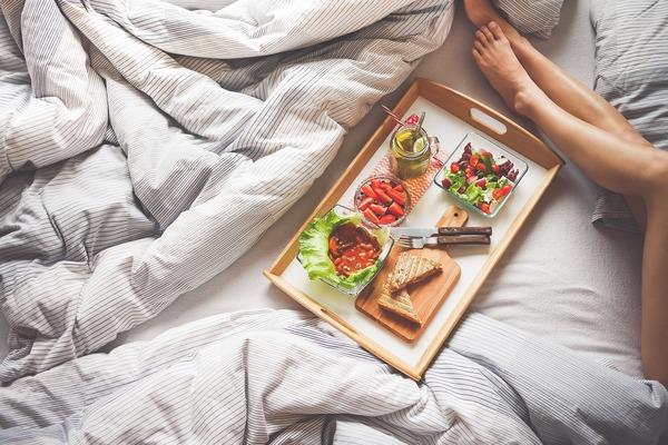 overhead shot of breakfast in bed