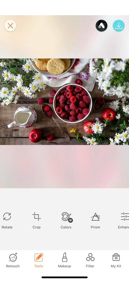 flat lay of flowers and red berries
