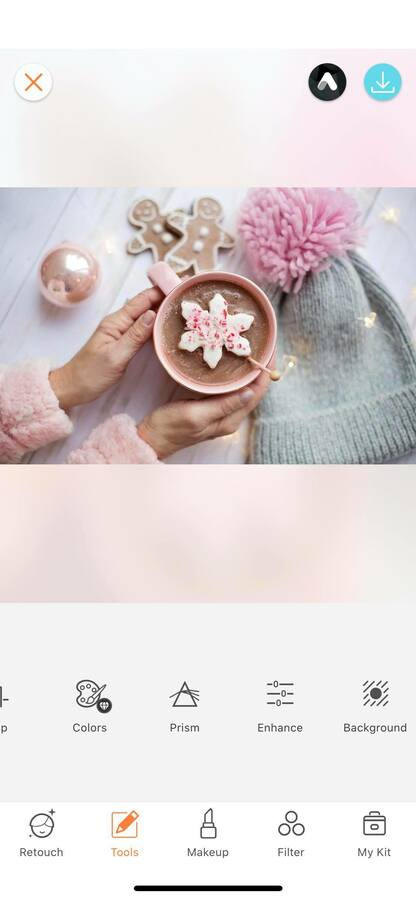 pink Christmas flat lay with snowflake cookie and grey and pink hat