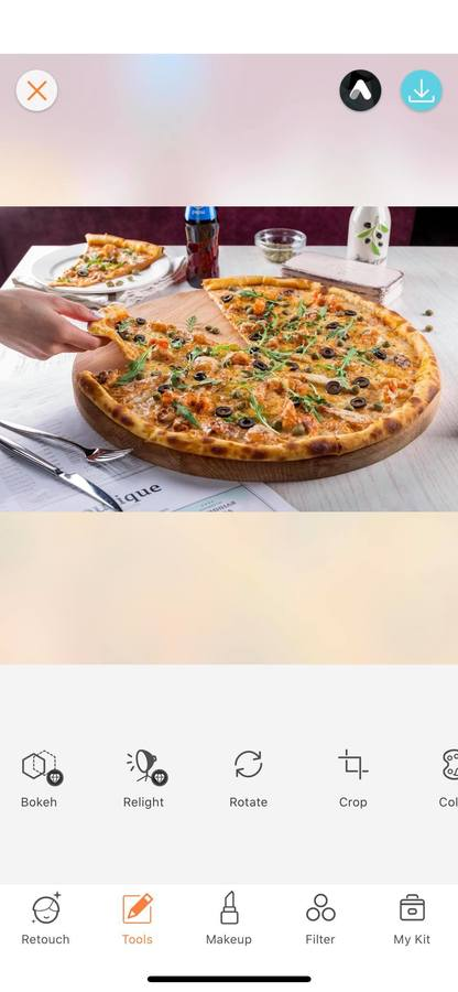hand reaching for slice of pizza