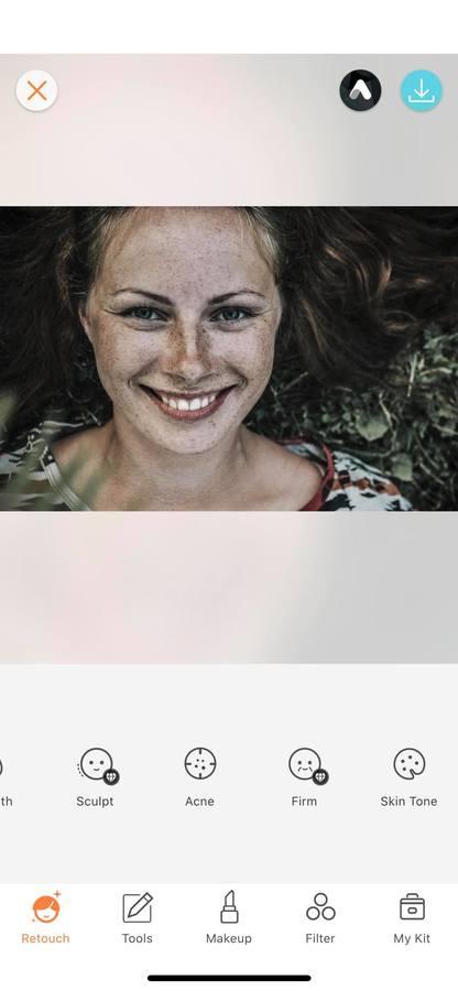 closeup of smiling woman looking up at camera