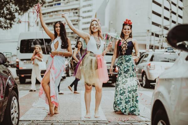 three women in a street parade
