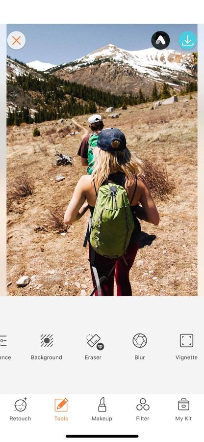 two people hiking in the hills
