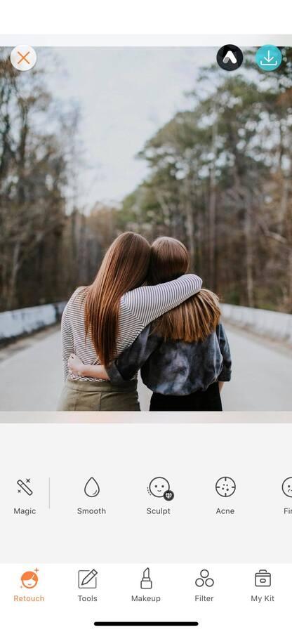 the backs of two women hugging