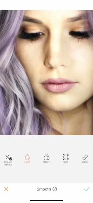 zoomed in photo of woman's face with purple hair
