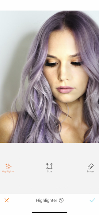 close up of woman with purple hair in front of white background