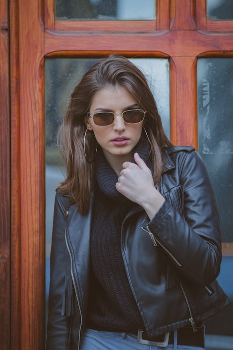 woman wearing black leather jacket and sunglasses