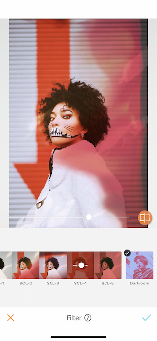 woman in a white jacket wearing Halloween makeup