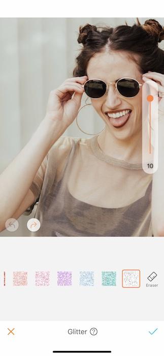 closeup of laughing woman wearing sunglasses