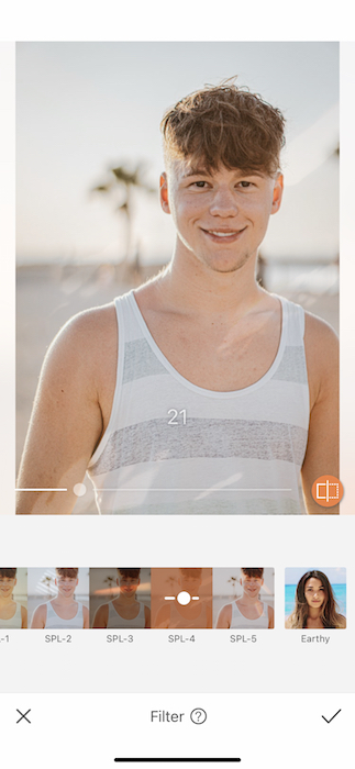 young man in white and grey tank top at the beach