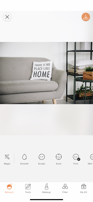 """gray sofa with pillow that says """"There's no place like home"""""""