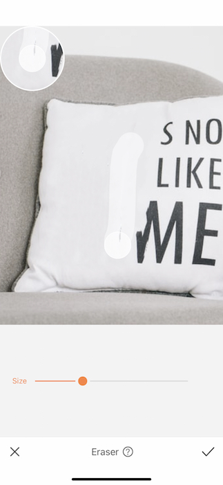 Closeup of white pillow with black writing
