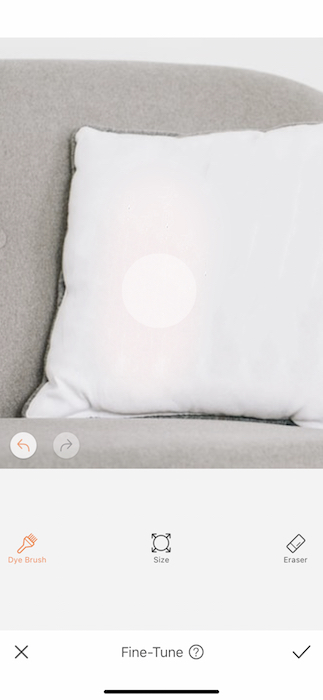 closeup of white pillow on grey couch