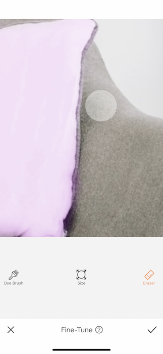 closeup of purple pillow on grey couch