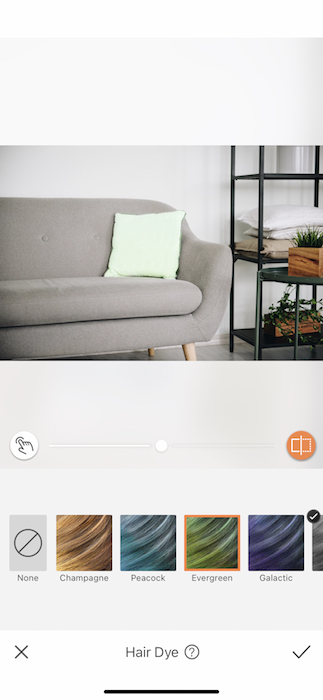 green pillow on grey couch