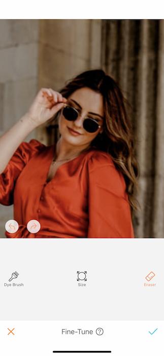 closeup of woman wearing orange dress and sunglasses