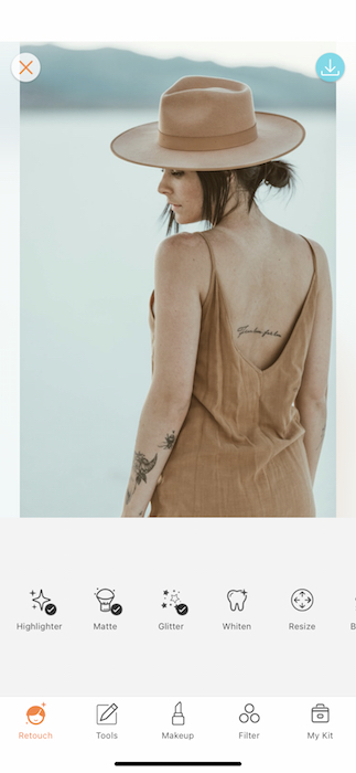 woman with tattoos wearing khaki dress and hat