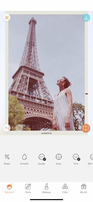 vintage photo of white woman standing in front of the Eiffel Tower