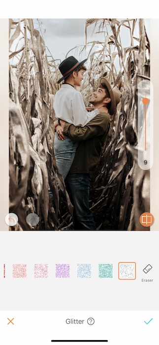 smiling couple embracing in a corn field