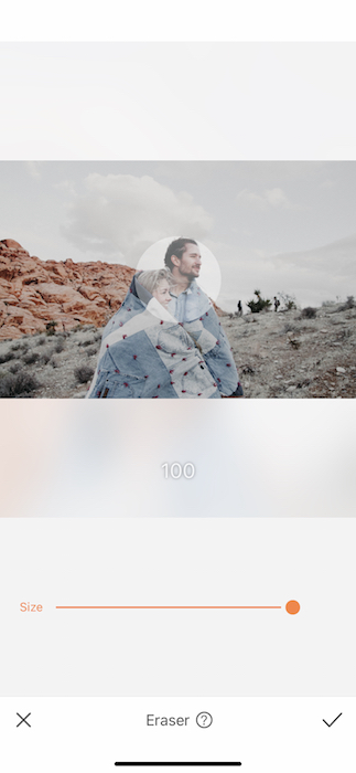 couple in the desert wrapped in a large blanket