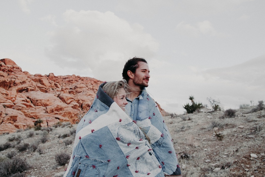 2020 AirBrush edit of couple in desert wrapped in a blanket