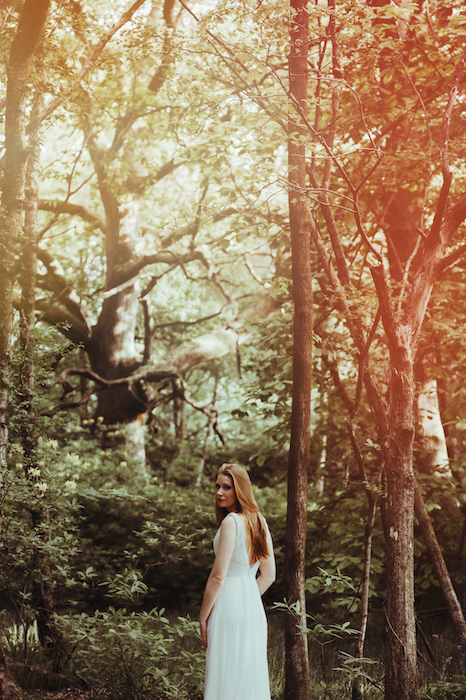 Picture of a white woman in the forest with the Flame Filter