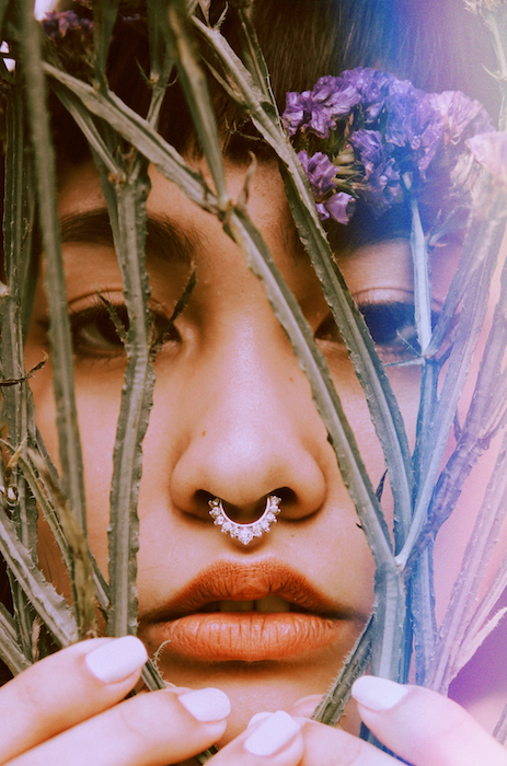 Picture of a woman with flowers close to her face with the Skyline Filter