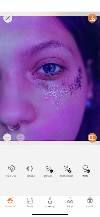 It's an image of a white girl, with blue eyes and glitter in her eyes, being edited with AirBrush App.