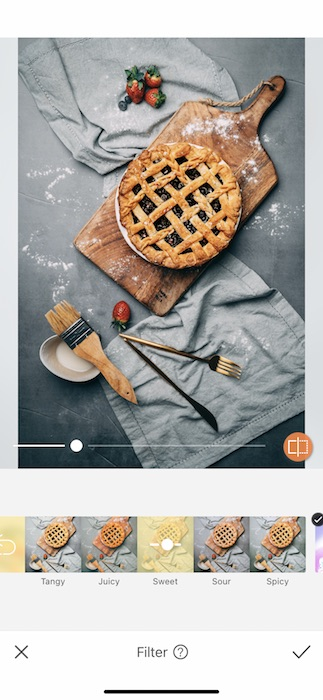 blueberry pie on cutting board with ingredients