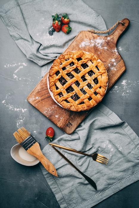 edited photo of blueberry pie with ingredients