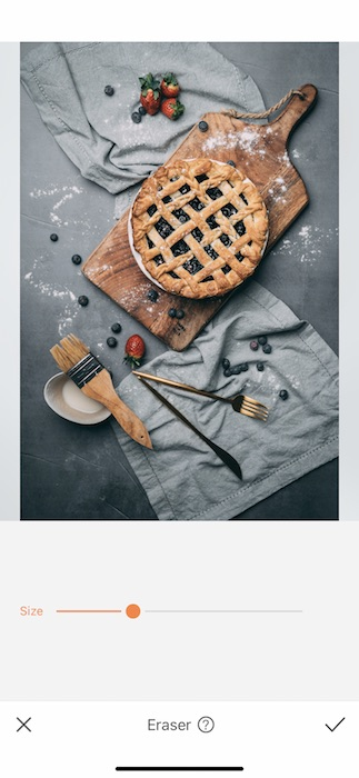 pie on cutting board with fruits and kitchen towels