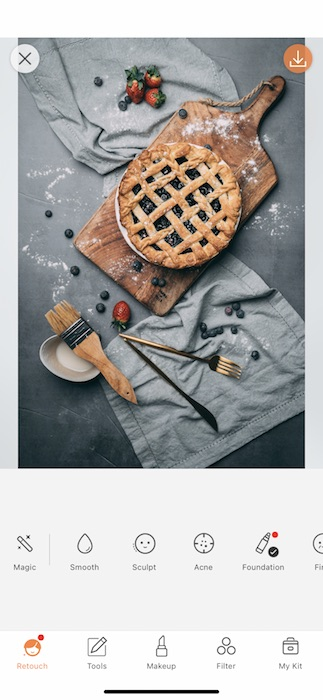pie on cutting board surrounded by fruits