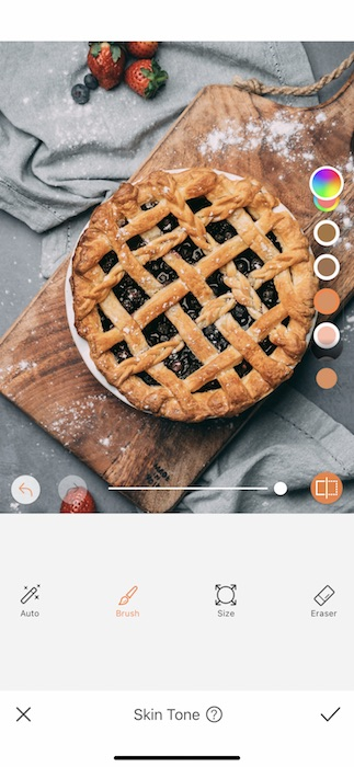 close up of blueberry pie against grey background
