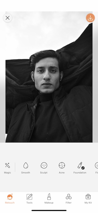 Black and white photo of man in black jacket