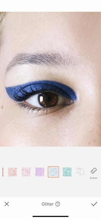 closeup of brown eye with blue eyeliner