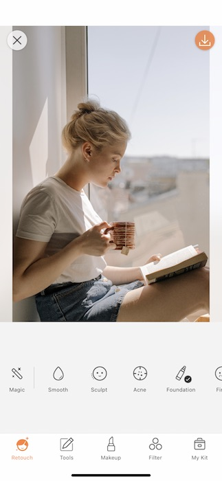 Picture of a white woman with pink hair drinking tea being edited with the Contrast, by AirBrush