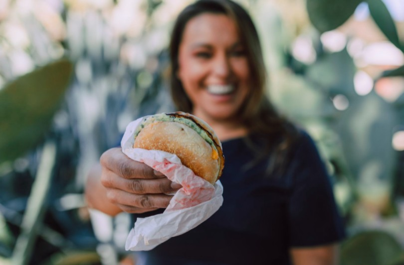 happy girl holding a burger