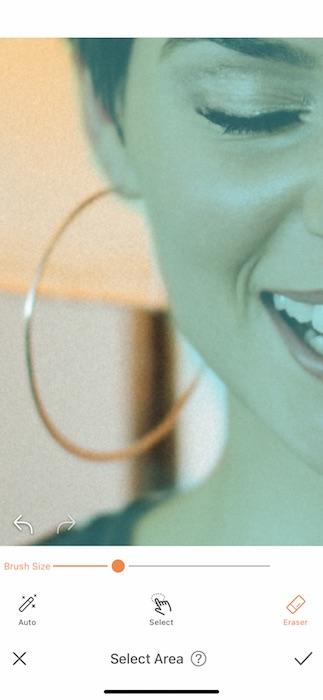 closeup of woman wearing large hoop earring