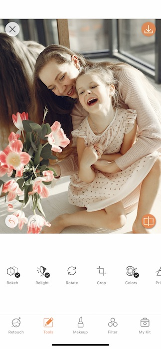closeup of mother hugging toddler daughter and laughing