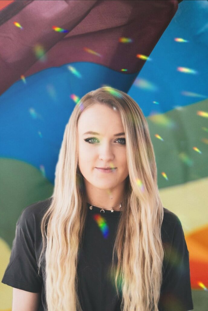 Pride Month edit of blonde woman wearing a black tshirt in front of colorful background