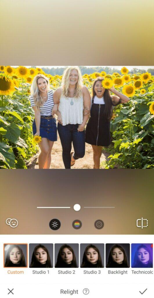 three women in a sunflower field