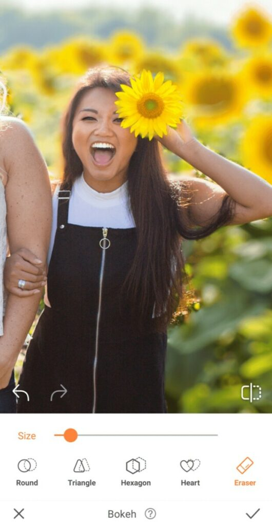 laughing woman holding a sunflower